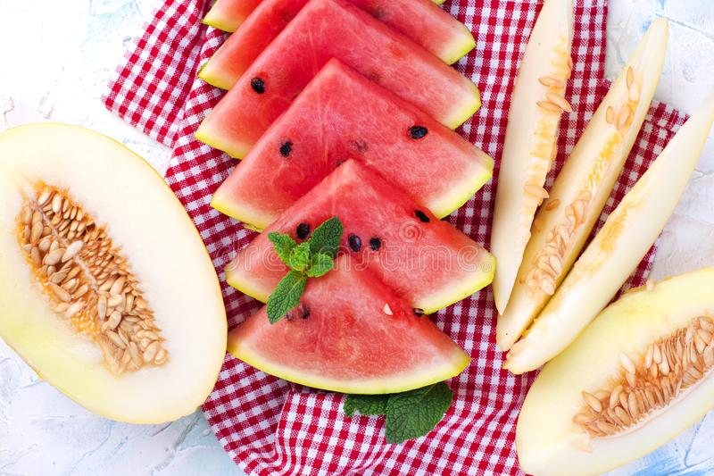 Sweet aromatic melon and watermelon. Summer fruits. Dietary food. Vitamins . stock photo