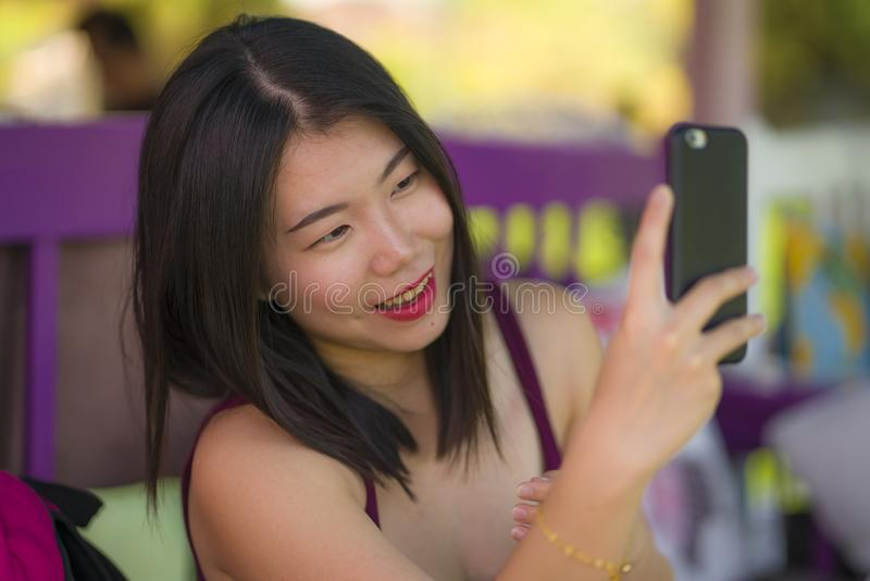 Sweet Asian girl taking selfie with hand phone . young beautiful and happy Korean woman taking self portrait photo smiling royalty free stock images