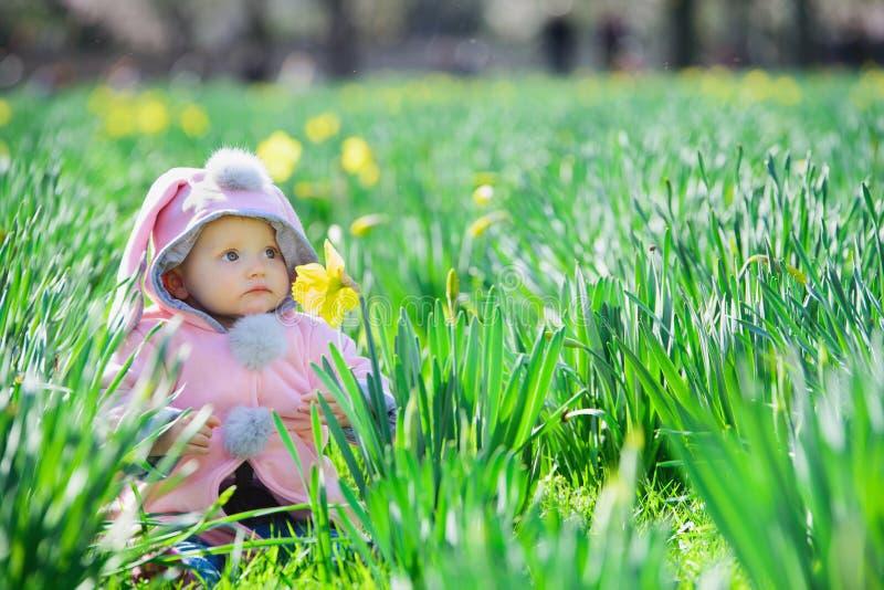 Sweet baby girl in park stock photos
