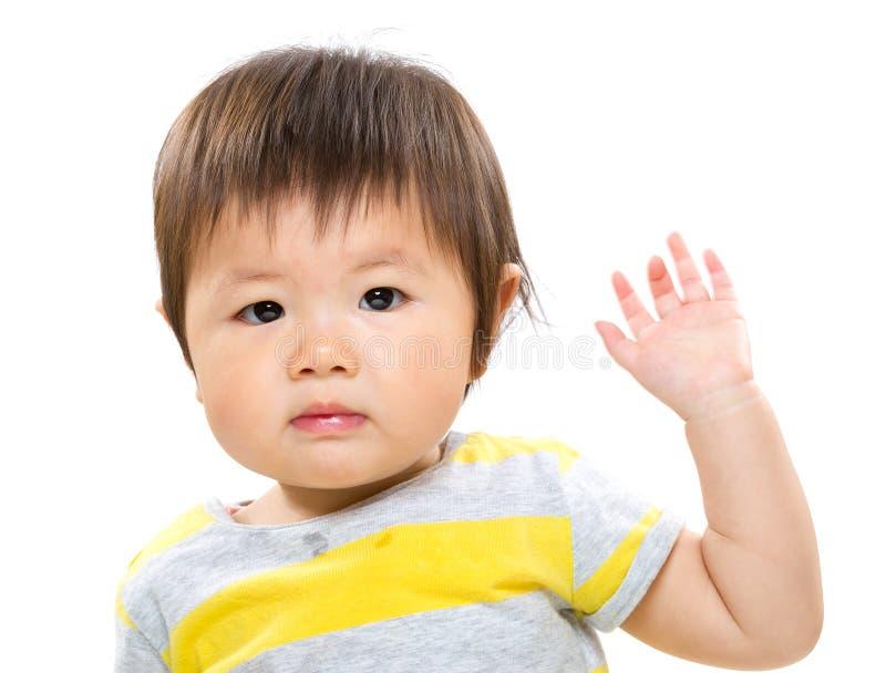 Sweet baby girl wave arm stock photo