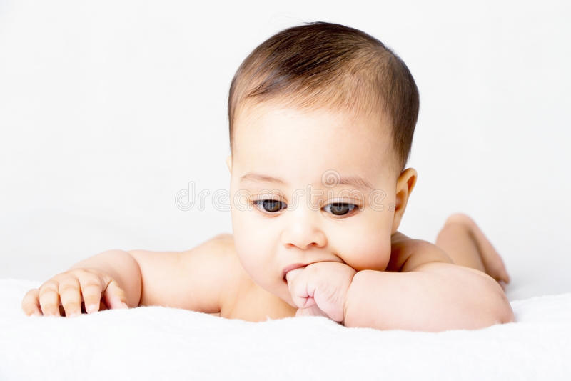 Sweet baby sucking his finger stock photos