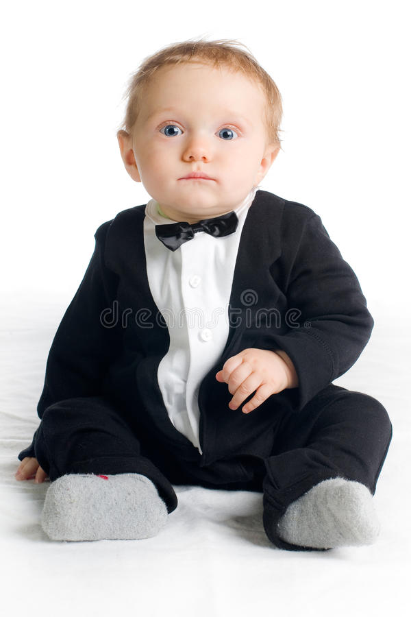 Sweet baby in tailcoat royalty free stock image
