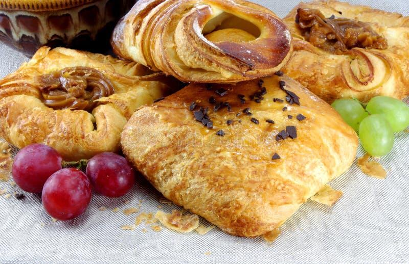 Sweet bakery buns and grapes stock photos