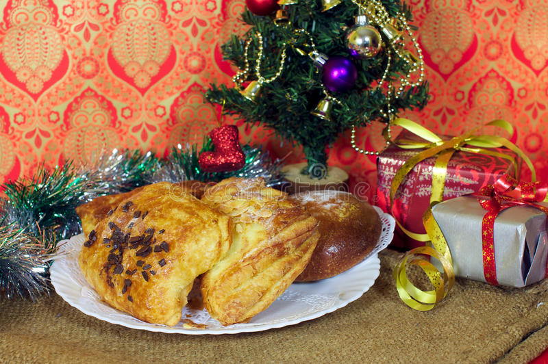 Sweet bakery for Christmas gift and decorated tree stock images