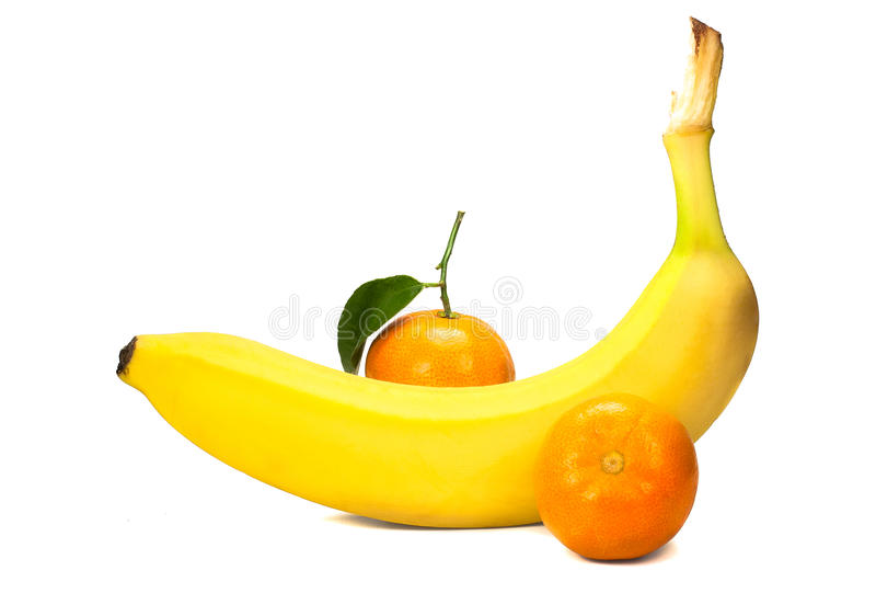 Sweet banana and two tangerine royalty free stock photography