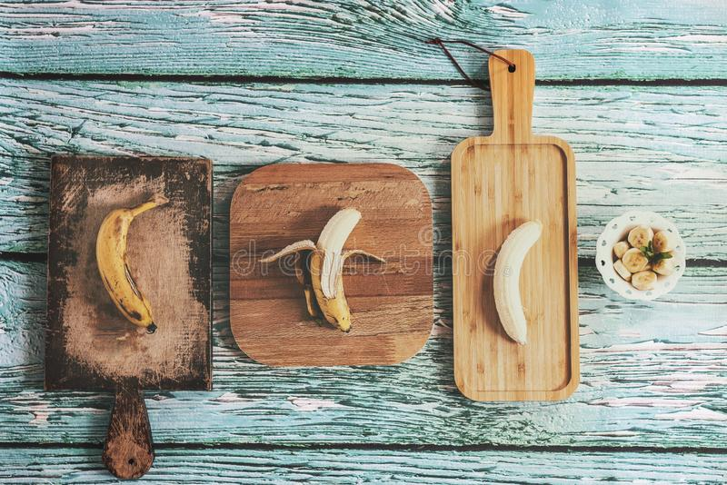 Sweet bananas on wooden table stock image