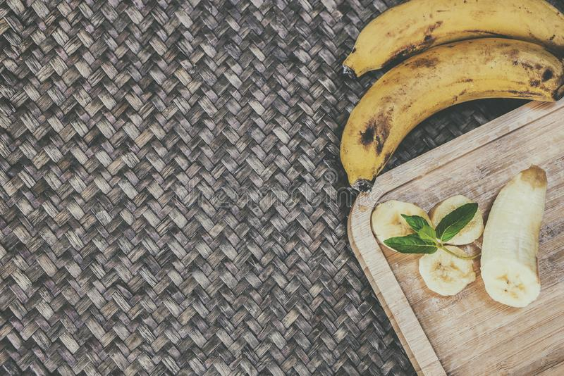 Sweet bananas on wooden table stock photo