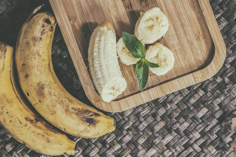 Sweet bananas on wooden table royalty free stock photography