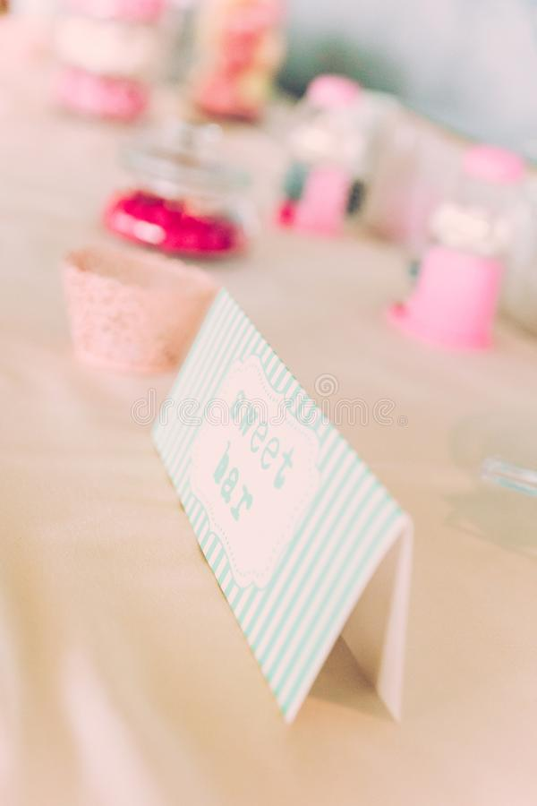Sweet Bar Paper Sign on Wedding Table with Coloured Sweets stock image