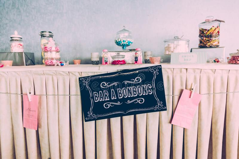 Sweet Bar Paper Sign on Wedding Table with Coloured Sweets royalty free stock photo