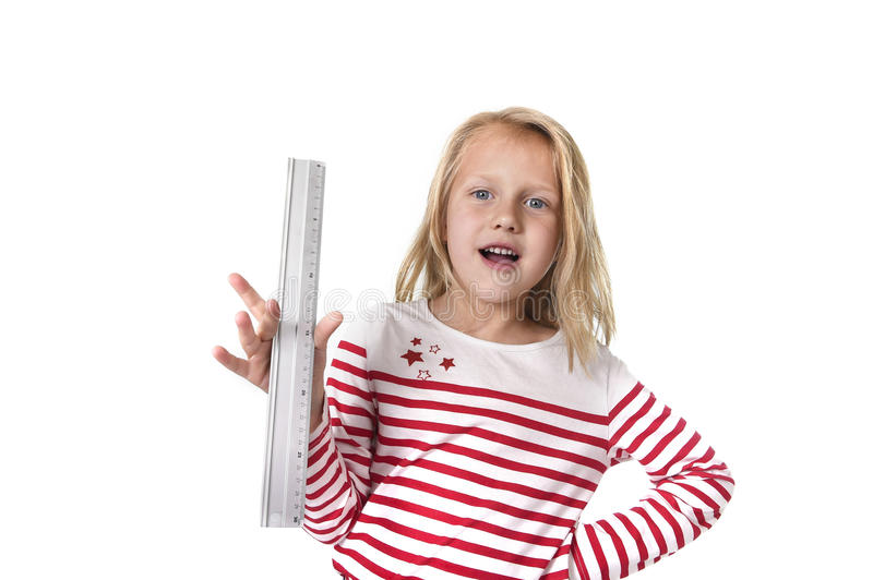 Sweet beautiful female child holding ruler school supplies concept stock photo