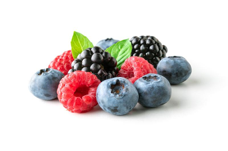 Sweet berries mix isolated on white background. Ripe raspberry, blueberry and blackberry stock image