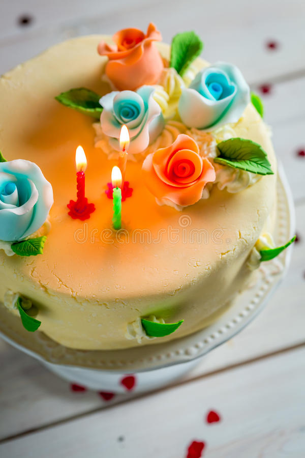 Sweet Birthday Cake Decorated With Candles And Roses Stock Photo