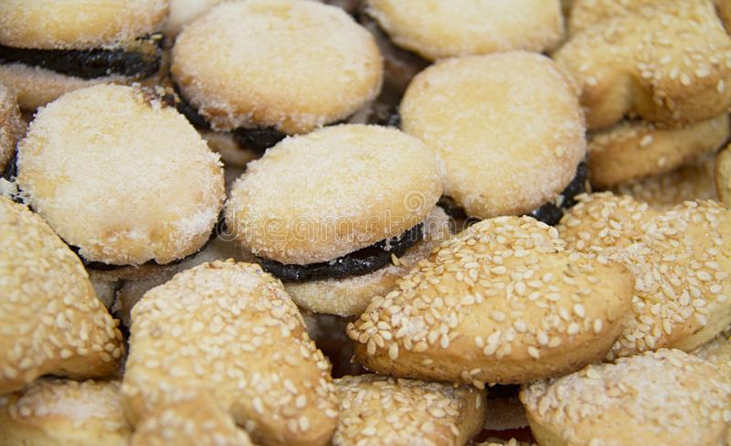 Sweet biscuits with jam and sesame. Heart-shaped and circular. stock photos
