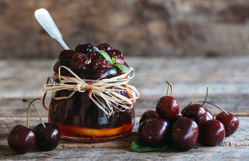Sweet black cherry jam stock photography