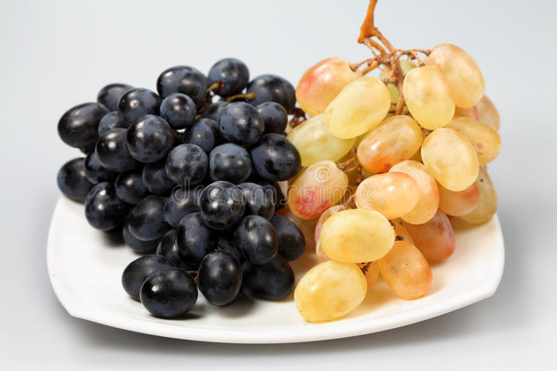 Sweet black and pink grapes royalty free stock photos