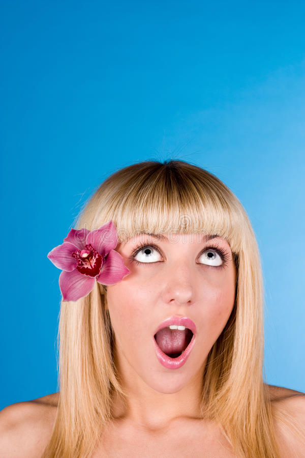 Sweet blond looking up stock images