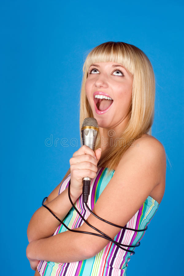 Download Sweet Blonde Sings Into A Microphone Stock Photo - Image: 14550414