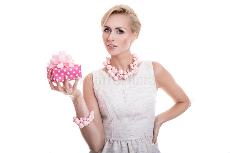 Sweet blonde woman holding small gift box with ribbon stock image