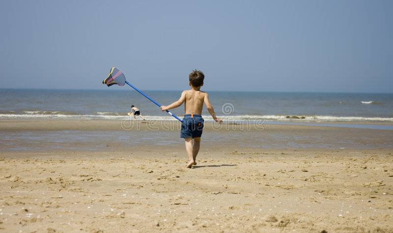 Sweet boy fishing at the beach royalty free stock images