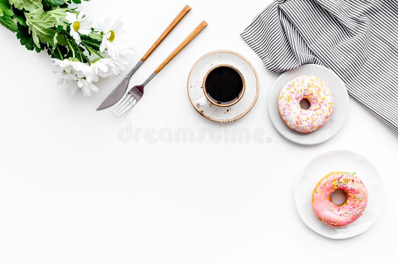 Sweet breakfast for a loved one. Coffee, dessert, flower on white table top view copy space royalty free stock photo