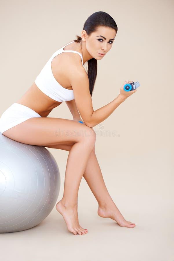Download Sweet Brunette Doing Fitness Exercises Stock Photo - Image of sportswear, female: 29389622