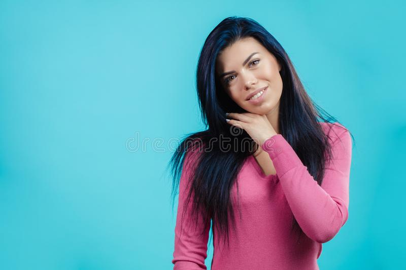 Sweet girl with tender healthy skin. Sweet brunette girl with tender healthy skin isolated on the blue background. copyspace royalty free stock photo