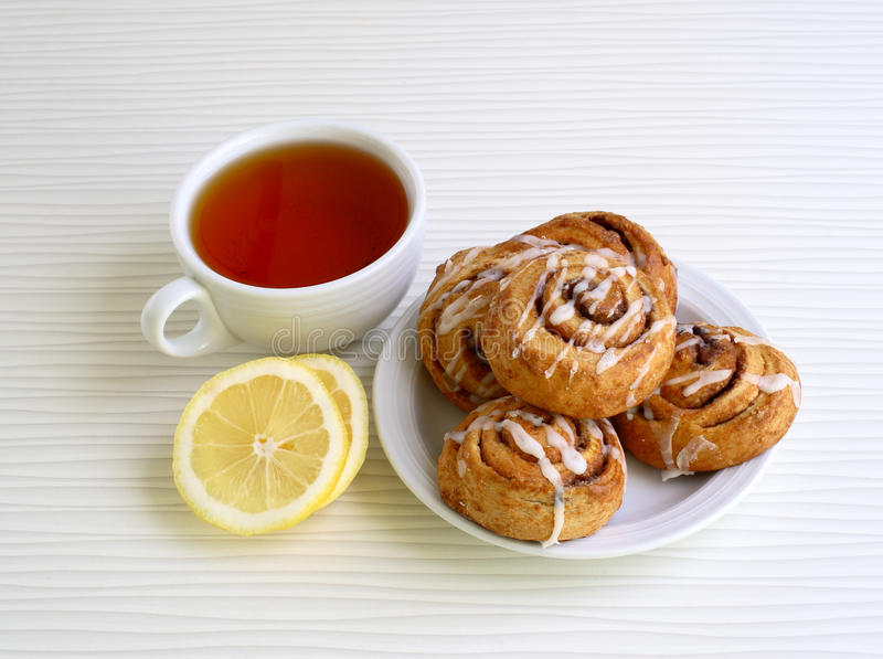 Sweet buns with cinnamon on a plate stock photo