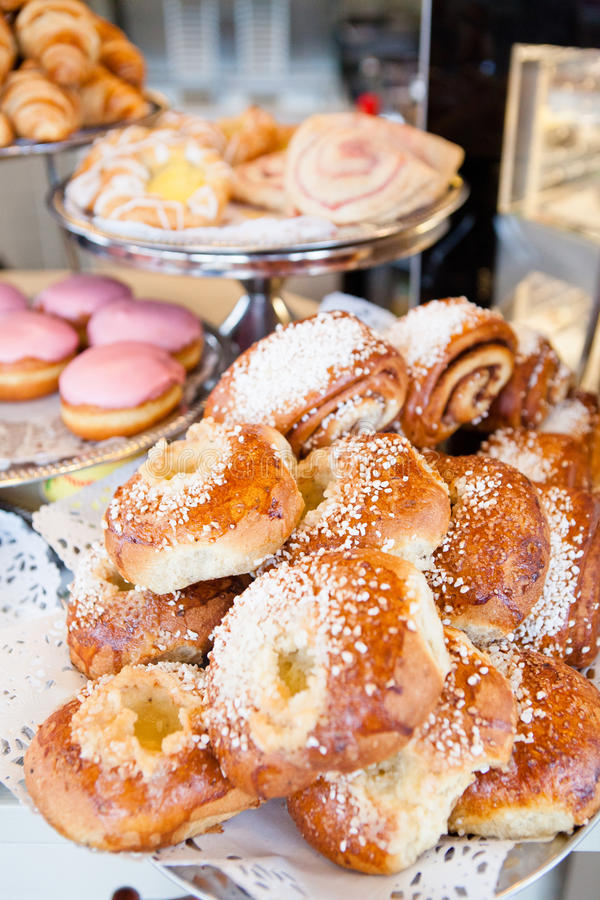 Sweet buns and donuts and croissants stock photo