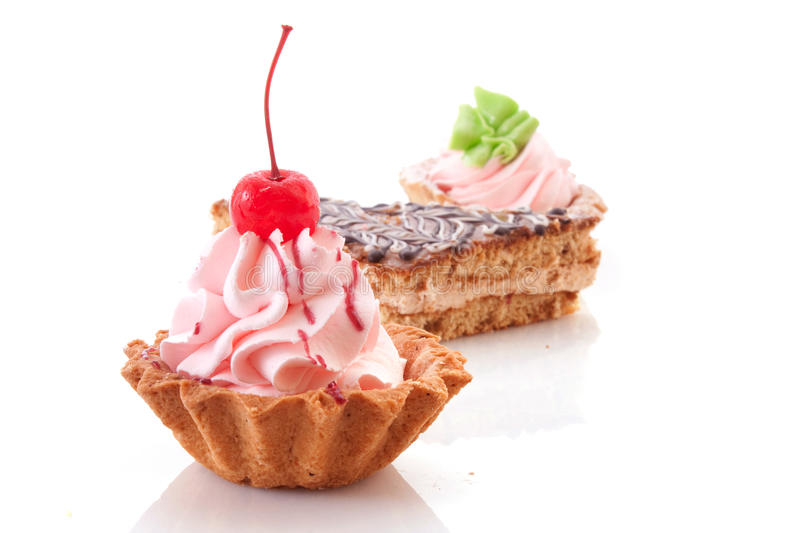 Sweet cake with cherry. Isolated on white royalty free stock image