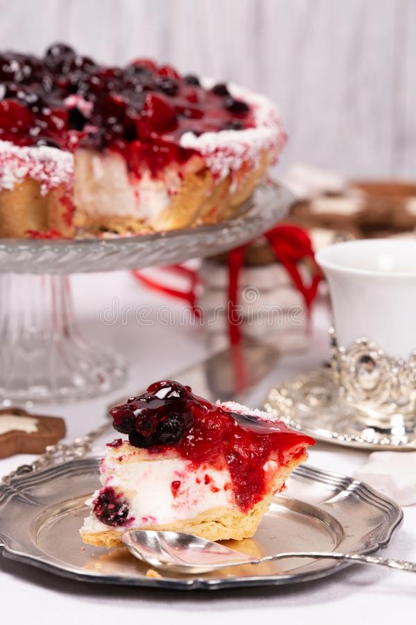 Sweet cake with cherry jelly, tasty and fresh. Antique dishes. Antique dishes on a white tablecloth and sweet cake with cherry jelly, tasty and fresh royalty free stock photo