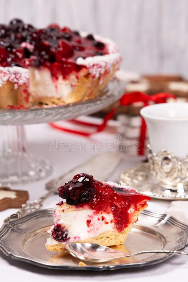 Sweet cake with cherry jelly, tasty and fresh. Antique dishes. Antique dishes on a white tablecloth and sweet cake with cherry jelly, tasty and fresh royalty free stock image