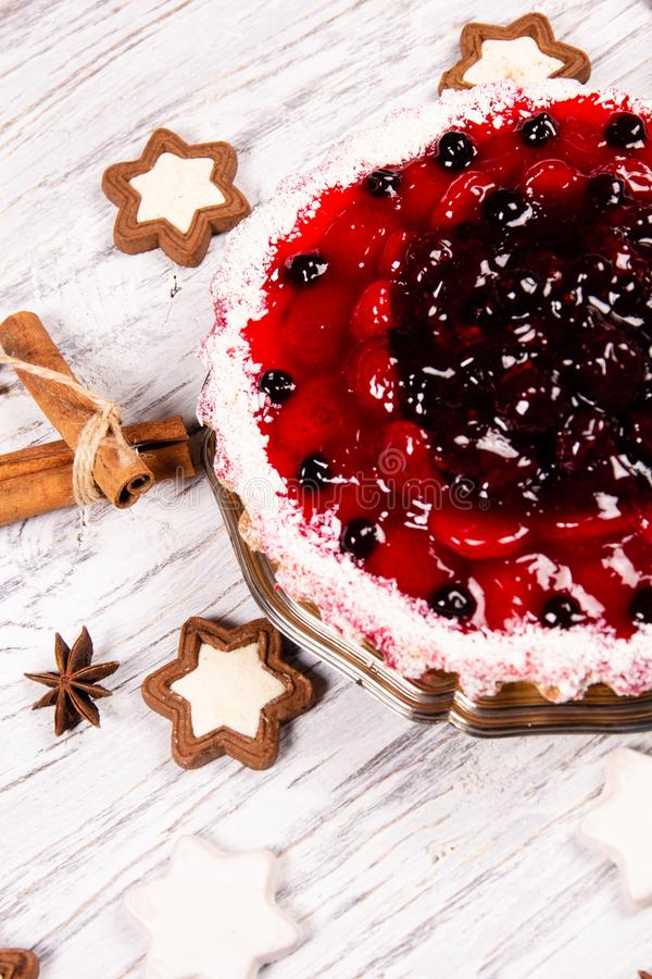 Sweet cake with cherry jelly, tasty and fresh on a white shabby wooden table. Sweet cake with cherry jelly, tasty and fresh stock images