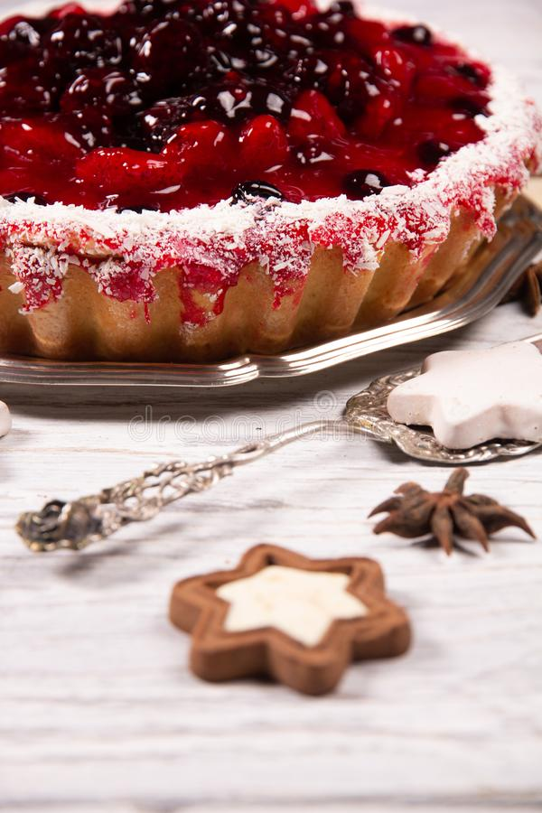 Sweet cake with cherry jelly, tasty and fresh on a white shabby wooden table. Sweet cake with cherry jelly, tasty and fresh stock image