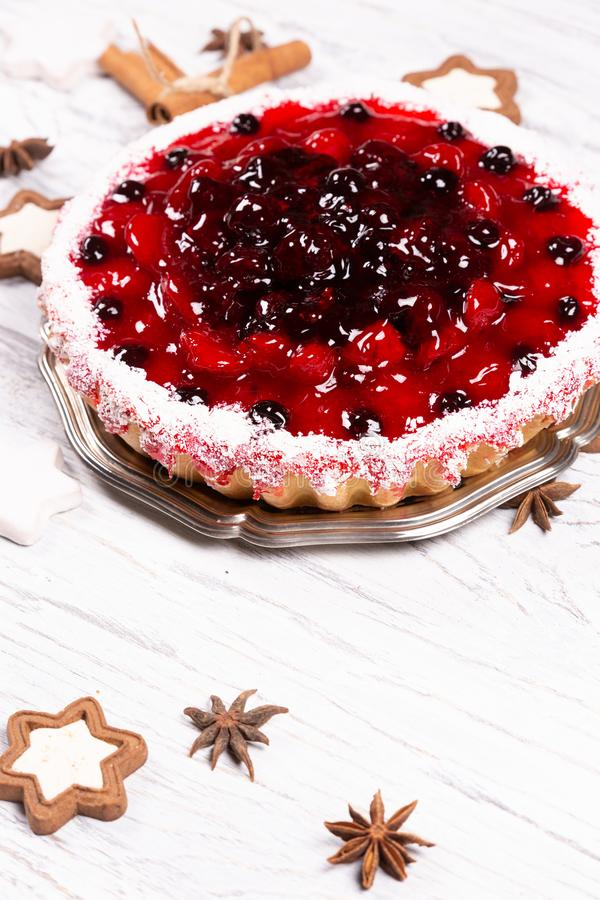 Sweet cake with cherry jelly, tasty and fresh on a white shabby wooden table. Sweet cake with cherry jelly, tasty and fresh royalty free stock photos