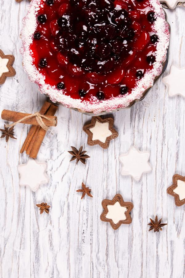 Sweet cake with cherry jelly, tasty and fresh on a white shabby wooden table. Sweet cake with cherry jelly, tasty and fresh stock photos