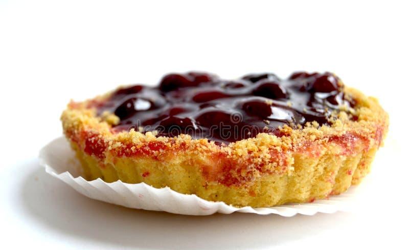 Cake with cherry on white background. Sweet cake with cherry on white background royalty free stock image