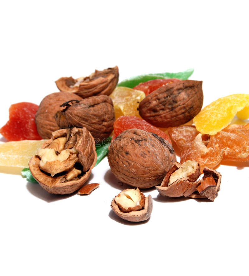 Sweet Candied Fruit And Nuts. On the white background stock photo