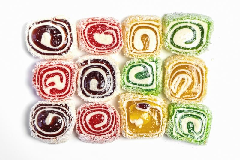 Sweet candy background. Colored candy on white background royalty free stock images