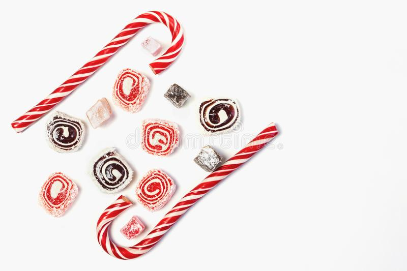 Sweet candy background. Red and maroon candies on white background. Top view. Copy space stock photos