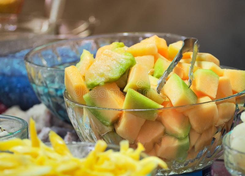 Sweet cantaloupe or melon with syrup in glass bowl. Thai dessert  ruam mit stock images
