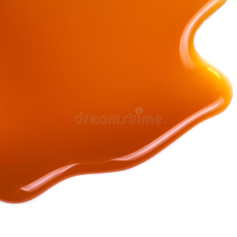 Sweet caramel sauce isolated on white background close up. Golden Butterscotch toffee caramel liquid . Sweet caramel sauce isolated on white background close up royalty free stock image