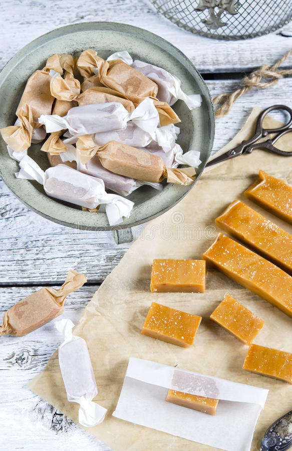 Sweet caramel toffee caramels. On wooden table stock image