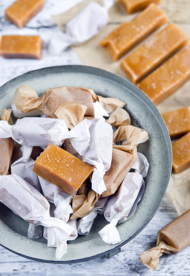 Sweet caramel toffee caramels. On wooden table stock photos