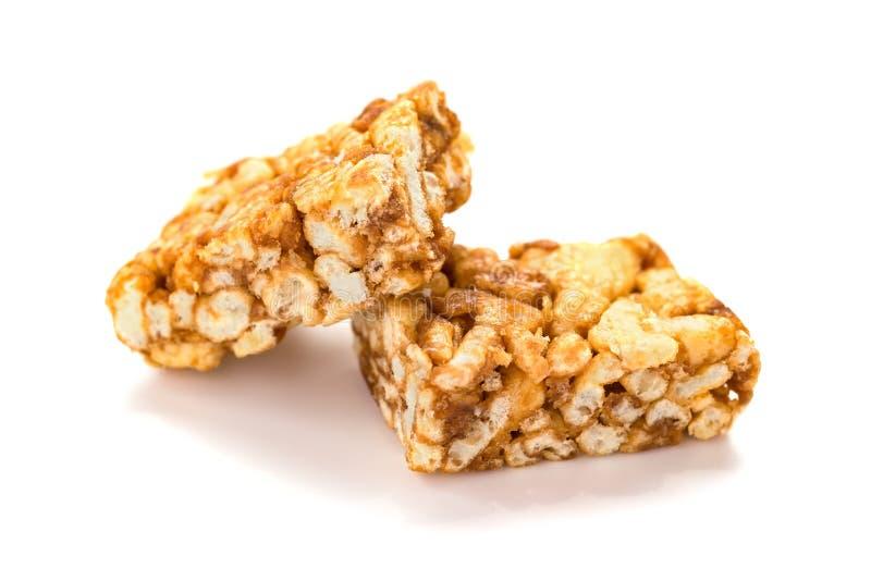 Sweet caramel treats on white background royalty free stock photos