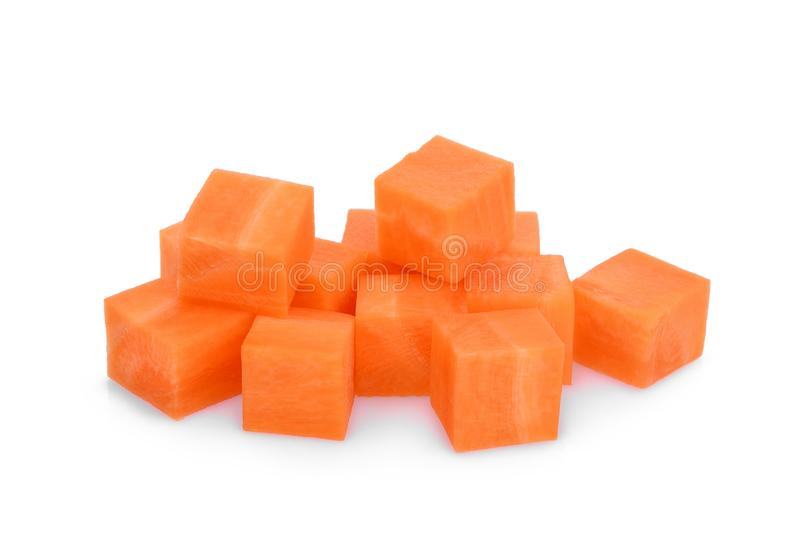 Sweet carrot cubes isolated on the white. Background stock images