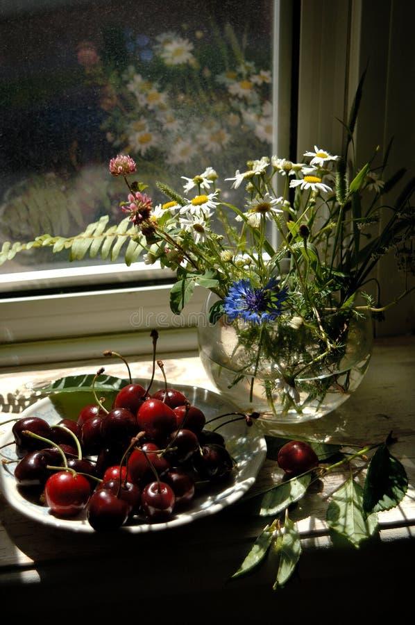 Sweet cherries, bunch of flowers stock photos