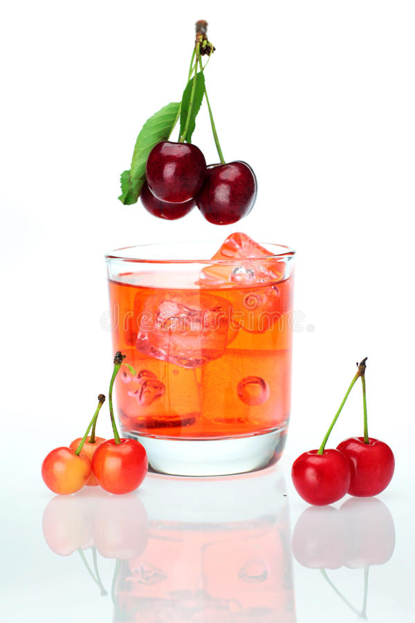 Sweet cherries and a cup of cherry juice stock photography