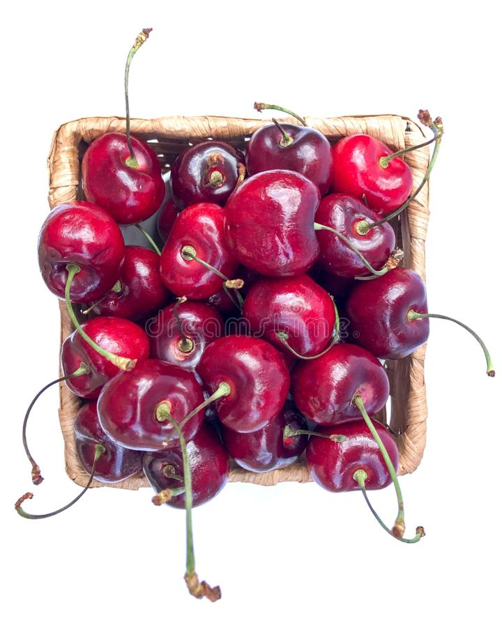 Sweet cherry in basket on white. stock image
