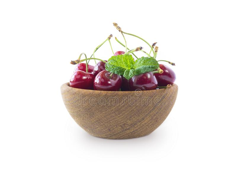 Sweet cherry berries isolated on white background cutout. Cherry fruit in a wooden bowl with copy space for text. Background of ch stock image